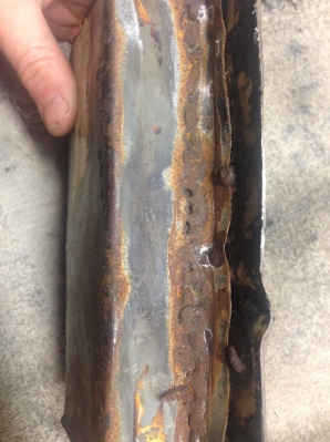 Rusted replacement frame rail side view of lap joint.